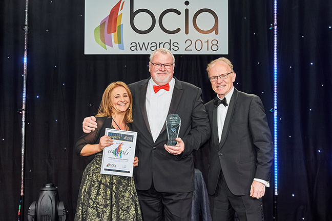 Alan Braybrook, business development director at Sontay (centre), accepts his award.